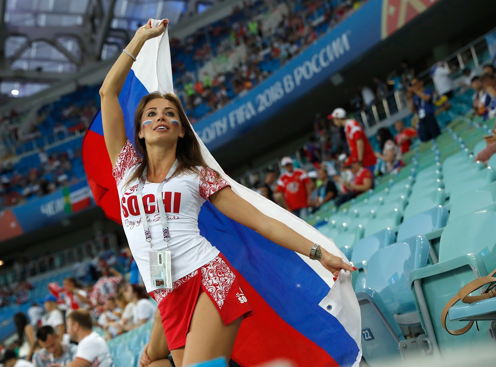 . A Russian fan holds a Russian flag prior to the start of the quarterfinal match between Russia and Croatia at the 2018 soccer World Cup in the Fisht Stadium, in Sochi, Russia, Saturday, July 7, 2018.(AP Photo/Pavel Golovkin)