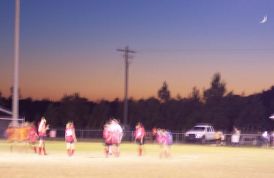 Warming up for a night game.  It's a chilly 76 degrees.  Can you see the moon in the sky?