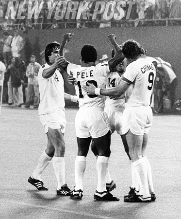 Pele SCORES! Roth and Chinaglia NY Cosmos teammates congratulate Pele after the score. 1977