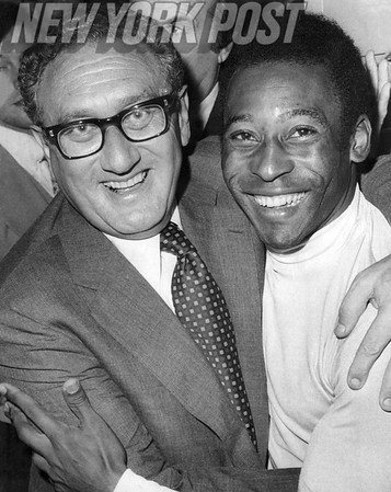 Pele enjoys a visit with Henry Kissinger in the NY Cosmos locker room. 1977