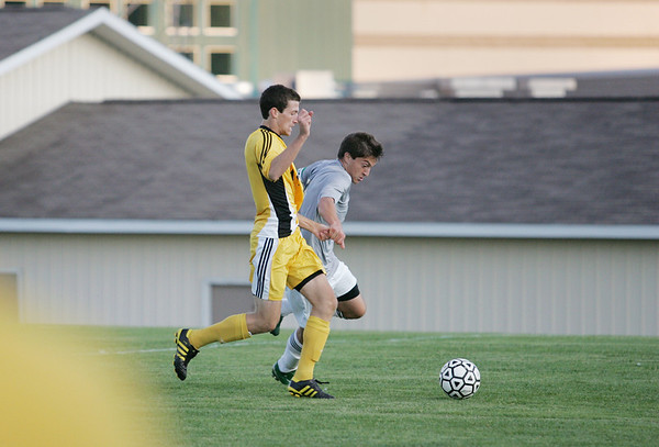 Record-Eagle/Keith King<br /> Traverse City Central's Keanen Armour, left, and Traverse City West's JJ Breithaupt battle for control of the ball Tuesday, September 13, 2011 at Traverse City West High School.