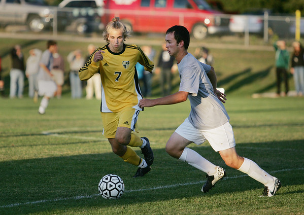Record-Eagle/Keith King<br /> Traverse City West's Alex Wyant, right, is pressured by Traverse City Central's Trevor Osburn Tuesday, September 13, 2011 at Traverse City West High School.