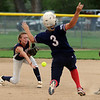"Sami Fagan, left, of North Florida, flips the ball to Ryan Iamurri to get Ally Carda of the Lady Magic out.<br /> The Lady Magic of California played the Team North Florida in the 18 and under Championship game on Sunday.<br /> For more photos of the game, go to  <a href=""http://www.dailycamera.com"">http://www.dailycamera.com</a>.<br />  Cliff Grassmick / July 4, 2010"