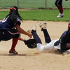 "Kiara Garcia, left, of the Lady Magic, doesn't get the tag at second on time on Haley Fagan of North Florida.<br /> The Lady Magic of California played the Team North Florida in the 18 and under Championship game on Sunday.<br /> For more photos of the game, go to  <a href=""http://www.dailycamera.com"">http://www.dailycamera.com</a>.<br />  Cliff Grassmick / July 4, 2010"