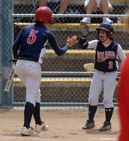 "Haley Fagan (5) celebrates with Ryan Iamurri after the North Florida  scores.<br /> The Lady Magic of California played the Team North Florida in the 18 and under Championship game on Sunday.<br /> For more photos of the game, go to  <a href=""http://www.dailycamera.com"">http://www.dailycamera.com</a>.<br />  Cliff Grassmick / July 4, 2010"
