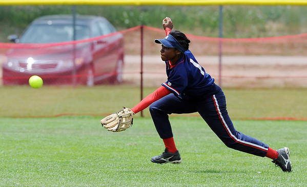 """Simone Heyward of the Lady Magic, stretches out to make the catch.<br /> The Lady Magic of California played the Team North Florida in the 18 and under Championship game on Sunday.<br /> For more photos of the game, go to  <a href=""""http://www.dailycamera.com"""">http://www.dailycamera.com</a>.<br />  Cliff Grassmick / July 4, 2010"""