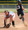 Powell Valley #11 Chabrae Roark catches the ball as Jessica Reamy #13 runs past her to second. Photo by Erica Yoon