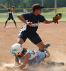 William Campbell Generals #10 Rasheeda Crews catches the ball as #7 Cassie Sturgill of Powell Valley slides back into third base. Photo by Erica Yoon