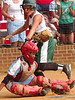 Powell Valley catcher, #4, is knocked down by rivial Battle catcher, #33, after she had already crossed the plate. Photo by ned Jilton II