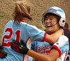 #'s 21 and 23 for Powell Valley celebrate after 23 scores the winning run from second base with two out in the last inning of regulation to send the Lady Vikings to Radford. Photo by ned Jilton II