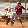 #4 for Dobyns Bennett beats the throw to third base as #11 for Central fields the throw. Photo by Ned Jilton II
