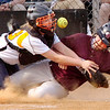 #31 for Dobyns Bennett tangles with Sullivan Central's catcher at home plate as the ball pops out. Photo by Ned JIlton II