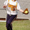 #33, the right fielder for Sullivan Central, makes a running catch. Photo by Ned Jilton II