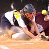 #31 for Dobyns Bennett tangles with Sullivan Central's catcher at home plate to score as the ball pops out. Photo by Ned JIlton II