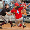 The D-B pitcher makes the tag on South's #4 after ball gets away from D-B catcher. Photo by Ned Jilton II