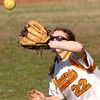Central's Jessika Samples, #22, battles the sun while attempting to catch a fly ball. Photo byNed Jilton II