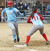 Sullivan South #13 T. Fink runs in to first against Powell Valley #11 Cassie Chadwell. Photo by Erica Yoon