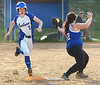 Coeburn's #2, Courtney Marrs, reaches first just a little late as Gate City's #12, B. Spivey holds onto the throw. Photo by ned JIlton II