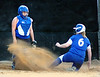 Gate City catcher, E. Everett, watches as her shoes are coved in dirt by the sliding #6, Lindsay Dean, of Coeburn. Photo by ned Jilton II