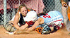 VHS catcher Hannah Smith, #12, tags the diving and sliding #25 of Powell Valley, Brittany Bishop, who attempted to tie the game after a wild throw to third base. Photo by Ned Jilton II