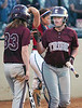 D-B's #1, Lily Gray, is greeted at home plate by #33, Abby Stratton after scoring the go ahead, and winning run. Photo by Ned Jilton II