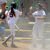 "Justine McLean, left, and  Amanda Lorenz, both of the California Team Mizuno, celebrate scoring the two runs for Team Mizuno in the 16-under Championship game.<br /> For more photos of the championship games, go to  <a href=""http://www.dailycamera.com"">http://www.dailycamera.com</a>.<br /> Cliff Grassmick / July 1, 2012"