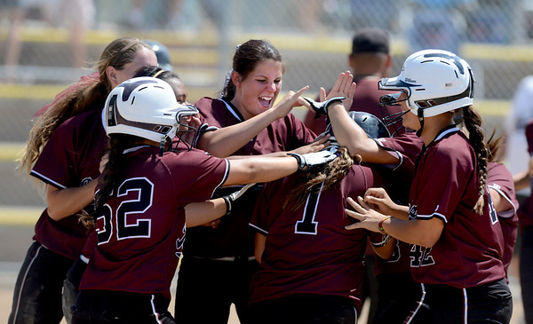 "Brittany Moeai (#1) is mobbed by her California Batbuster teammates after making the game winning hit to knock in 2 runs  in the bottom of the 9th to beat the SoCal Athletics in the 18-under Boulder Championship game.<br /> For more photos of the championship games, go to  <a href=""http://www.dailycamera.com"">http://www.dailycamera.com</a>.<br /> Cliff Grassmick / July 1, 2012"