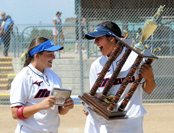 "Hannah Flippen, left, and Alyssa Palomino of the California Team Mizuno, holds the 16-under Championship hardware after their team beat the Corona (CA) Angels on Sunday.<br /> For more photos of the championship games, go to  <a href=""http://www.dailycamera.com"">http://www.dailycamera.com</a>.<br /> Cliff Grassmick / July 1, 2012"
