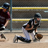 "Delaney Spaulding (99), left, of the California Batbusters, scores the winning run in the bottom of the 9th to beat the SoCal Athletics in the 18-under Boulder Championship game. Rachel Sellers of the Athletics gets the late throw.<br /> For more photos of the championship games, go to  <a href=""http://www.dailycamera.com"">http://www.dailycamera.com</a>.<br /> Cliff Grassmick / July 1, 2012"
