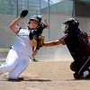 "Brittany Moeai, of the California Batbusters,  tags out  Taylor Koenig of the SoCal Athletics, in the18-under Boulder Championship game. <br /> For more photos of the championship games, go to  <a href=""http://www.dailycamera.com"">http://www.dailycamera.com</a>.<br /> Cliff Grassmick / July 1, 2012"