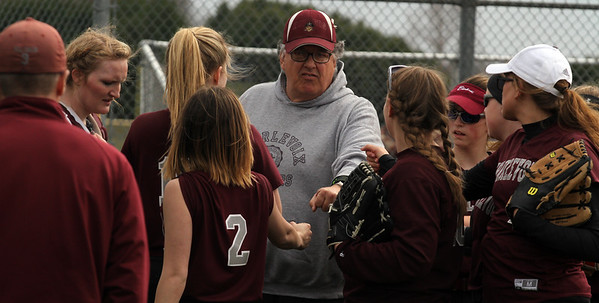 Record-Eagle/James Cook Charlevoix coach Tom Mielke, center, talks to his team Tuesday against Traverse City West.