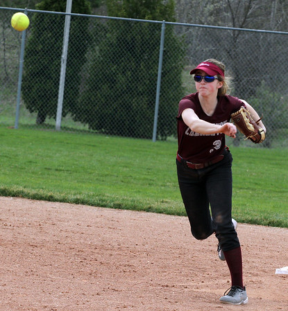 Record-Eagle/James Cook Charlevoix shortstop Hannah Solomon (33) throws to first in Tuesday's game at Traverse City West.