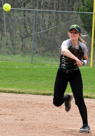 Record-Eagle/James Cook Traverse City West infielder Katelyn Steimel (6) throws to first Tuesday against Charlevoix.