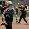 Record-Eagle/James Cook Charlevoix pitcher Shelby Wurst, right, throws to first as third baseman Haley Coss (10) looks on Tuesday at Traverse City West.