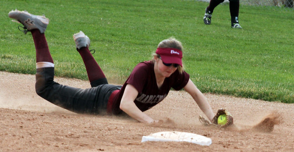 Record-Eagle/James Cook Charlevoix shortstop Hannah Solomon (33) dives to stop a hit up the middle in Tuesday's game at Traverse City West.