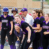 Record-Eagle/Brett A. Sommers Frankfort's Haley Myers' teammates wait at home plate following her tie-breaking home run during Saturday's regional championship game against Holton. Frankfort won 6-5.