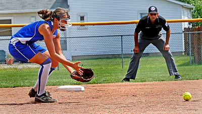 Croswell-Lexington softball win Noon Monday. Megan Guitar fields the ball from the shortstop position before throwing the runner out. Photo by . Photo by Tom Mahl