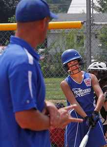 Croswell Lexington #3 Megan Guitar gets the sign from coach Andy Young before stepping into the batter's box. Photo by Tom Mahl