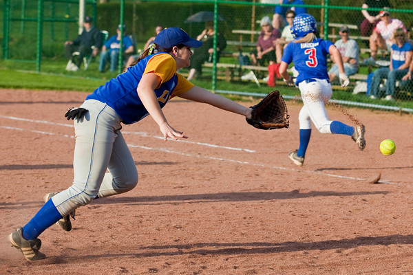 Gahanna High School's #7 Kim Lennox reaches for a bunt from Grove City High School's #3 Maci Haughn in the sixth inning of play against Grove City High School during their softball game held at Gahanna High School Wednesday afternoon April 14, 2010. (Photo by James D. DeCamp 614-462-8027)