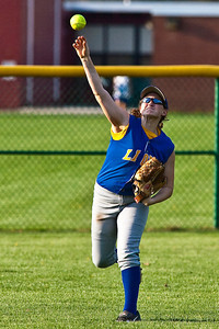 Gahanna High School's #8 Kelli Lennox throws an outfield hit back in during the sixth inning of play against Grove City High School during their softball game held at Gahanna High School Wednesday afternoon April 14, 2010. (Photo by James D. DeCamp 614-462-8027)