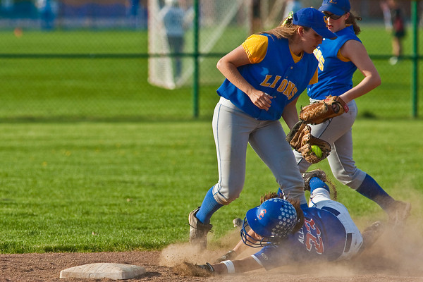Gahanna High School's #14 Sarah Seidel makes a tag of second base as Grove City High School's #23 Taryn Allmon slides in in the the fifth inning of play during their softball game held at Gahanna High School Wednesday afternoon April 14, 2010. (Photo by James D. DeCamp 614-462-8027)