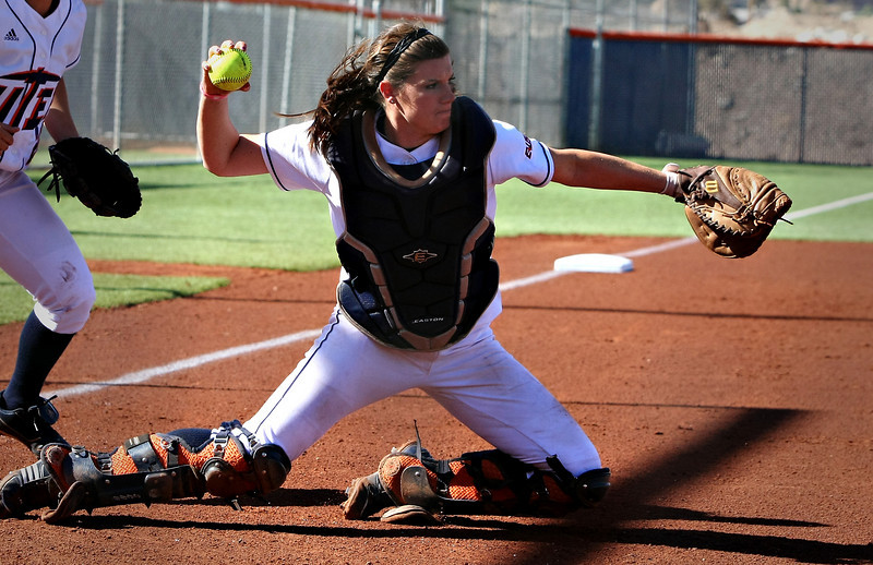 Kayleigh Walts making the throw to first