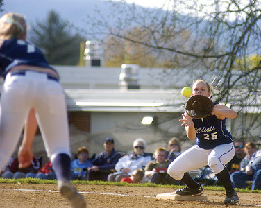 Mifflinburg's Ally Lloyd throws to Jess Brobst at first base on Tuesday's game with Central Columbia.