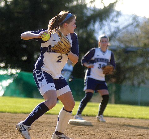 Central Columbia's Brooke Clarke throws to first base, Kimmy Hollister stands on second base.