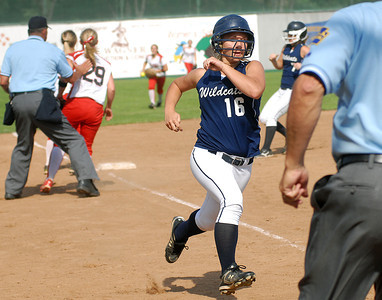 Mifflinburg's Cassie Lewis heads for home during their game against Troy Wednesday May 30, 2012 at Elm Park in Williamsport.