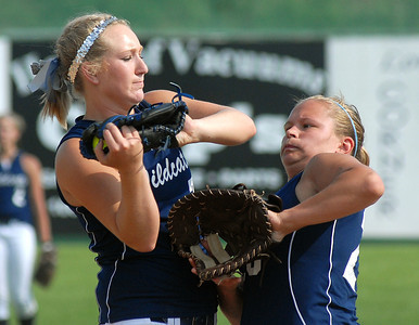Mifflinburg's pitcher, Ally Lloyd, and first baseman, Jess Brobst, avoid a collision get the out during their game against Troy Wednesday May 30, 2012 at Elm Park in Williamsport.