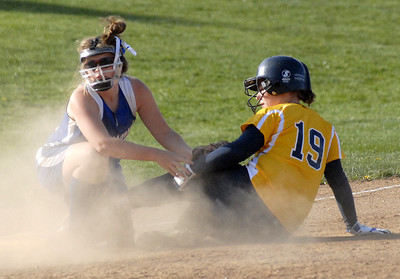 Selinsgrove's Jess Kerstetter looks for the call after tagging out Montoursville's Ashley Burger
