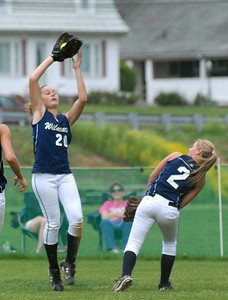 Mifflinburg's Sara Stauffer calls off teammate Makenzie Noll, 2, to make the catch during their game against Warrior Run Thursday May 3, 2012.