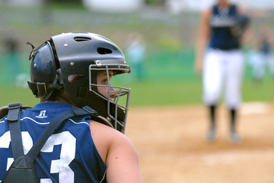 Mifflinburg's Kelcie Crabb gets the signs from the dugout during their 2-1 win over Warrior Run Thursday May 3, 2012.