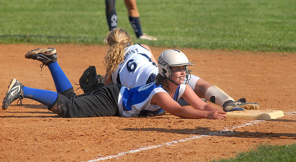 Warrior Run's Katy Swartz slides back to first ahead of the throw to Central's Paige Seigrist during their game Thursday May 24, 2012.